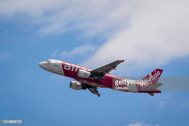 An Airbus A320216 passenger plane belonging to the AirAsia taking off at Hong Kong International Airport on August 08 2018 in Hong Kong Hong Kong...