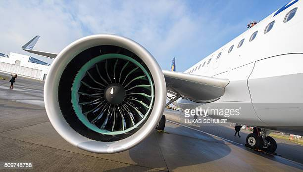 An Airbus A320neo plane with the logo of German airline Lufthansa stands on the factory site of Airbus on February 12 2016 in Hamburg northern...