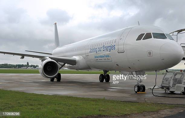 An Airbus A321 aircraft using Biojet A1 Total/Amyris a biofuel produced from an innovative sugarprocessing technology is parked on the tarmac at Le...