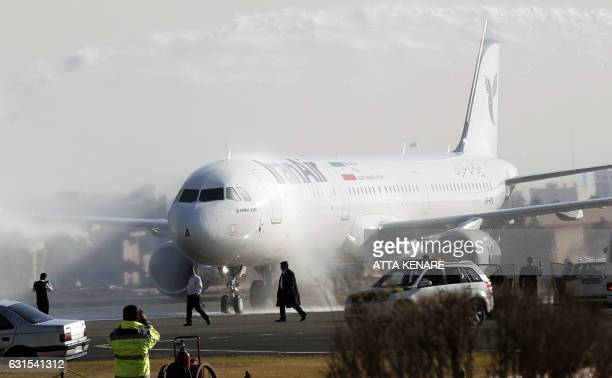 An Airbus A321 airliner arrives at the Mehrabad international airport during the delivery of the first batch of planes to the Iranian state airline...