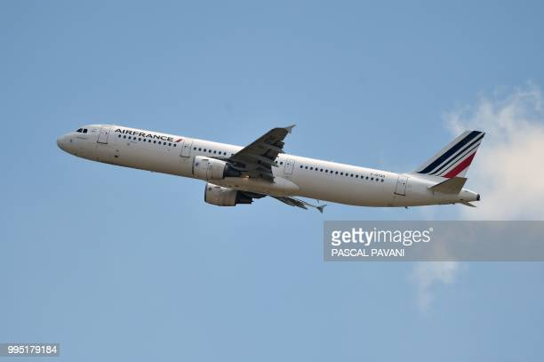 An Airbus A321 belonging to the Air France airline company flies on July 10 in Blagnac southwestern France