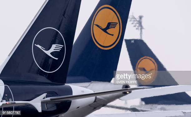 An airbus A321 displaying the new logo of the German airline Lufthansa is seen in front of planes displaying the old logo of the airline at the...
