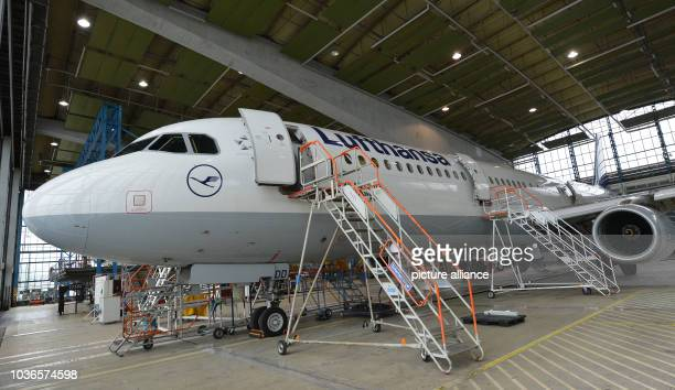 An Airbus A321 stands at the Lufthansa service hangar in Schoenefeld Germany 28 May 2014 The airline will equip twenty of their mediumrange aircrafts...