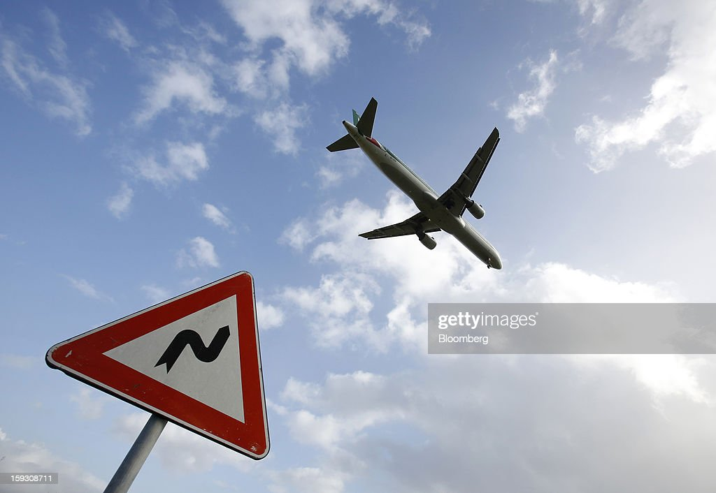 An Airbus A321-112 aircraft, operated by Alitalia SpA, prepares to land at Fiumicino airport in Rome, Italy, on Friday, Jan. 11, 2013. Former Italian Prime Minister Silvio Berlusconi's economic adviser said the European debt crisis has left his country's companies vulnerable to takeovers by foreign rivals and urged the government to prepare defences. Photographer: Alessia Pierdomenico/Bloomberg via Getty Images
