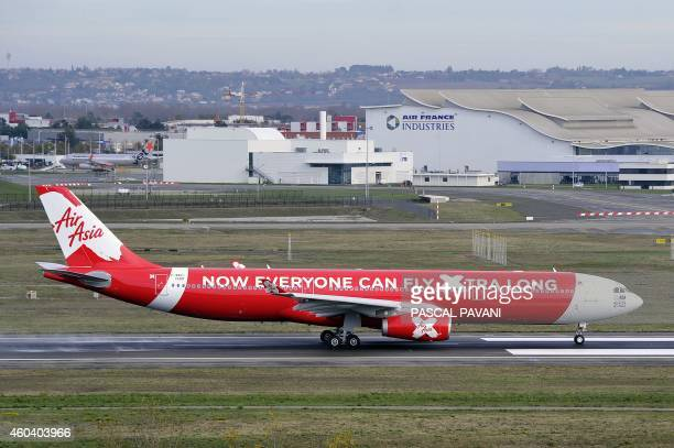 An Airbus A330 aircraft of the Malaysian company Air Asia prepares before taking off the Toulouse Blagnac airport on December 12 2014 in Blagnac AFP...