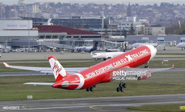 An Airbus A330 aircraft of the Malaysian company Air Asia takes off the Toulouse Blagnac airport on December 12 2014 in Blagnac AFP PHOTO / PASCAL...