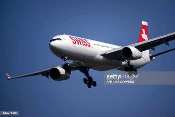 An Airbus A330 commercial plane of Swiss International Air Lines performs during the second weekend of the AIR14 air show on September 6 2014 in...