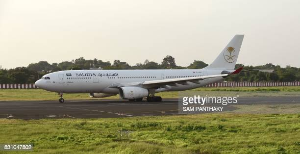 An Airbus A330 flight from Saudia with Indian Haj pilgrims on board prepares to depart from Sadar Vallabhbhai Patel International Airport in...