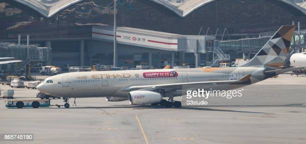 An Airbus A330 passenger plane operated by Etihad Airways is pushed back off the gate at Hong Kong International Airport on 23 October 2017 in Hong...