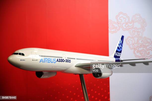 An Airbus A330 plane model is displayed during the inauguration ceremony of the Airbus Long Range Cabin Completion Centre in Tianjin on September 20...