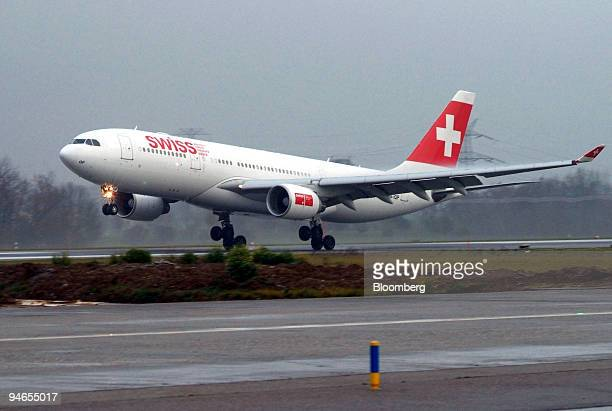 An Airbus A330 Swiss International flight arriving from New York City lands at Geneva Airport in Geneva Switzerland Wednesday November 29 2006