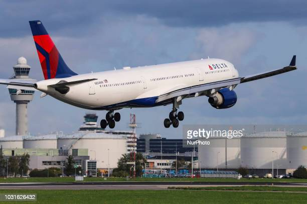 An Airbus A330300 of Delta Air Lines with registration N804NW is landing at Amsterdam Schiphol Airport in the Netherlands Delta uses Amsterdam...
