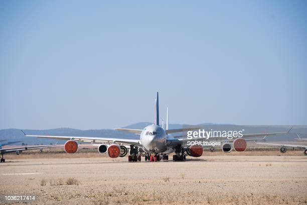 An Airbus A340 aircraft seen parked in Teruel airport with its engines covered Many people think Teruel airportis an aircraft graveyard where...
