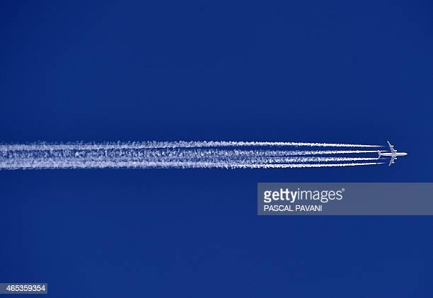 An Airbus A340 flies over the Sivens forest in the department of Tarn southwestern France on March 6 2015 AFP PHOTO / PASCAL PAVANI