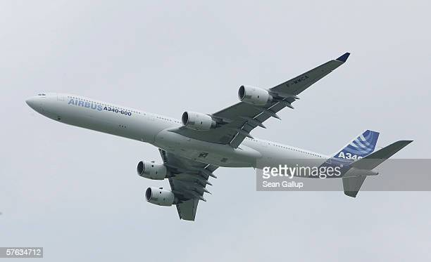 An Airbus A340 passenger jet flies over Schoenefeld Airport during the ILA Berlin Air Show May 16 2006 in Berlin Germany ILA is Germany's biggest air...