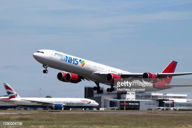 An Airbus A340-600 aircraft with 'Protect our NHS' branding takes off from Cardiff Airport on May 26, 2020 in Cardiff, United Kingdom. The British...