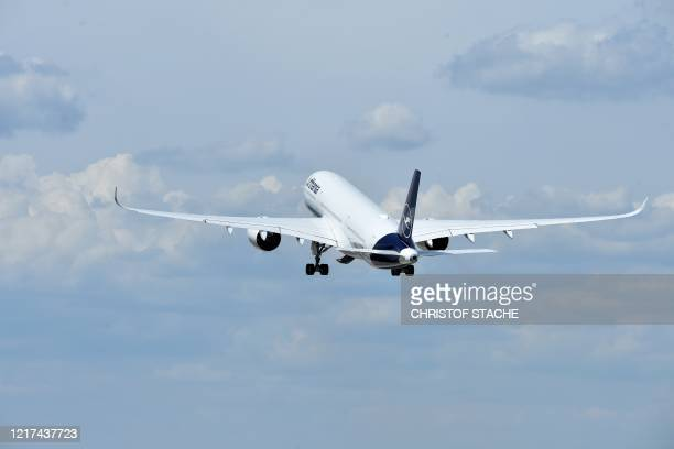 "An Airbus A350 of the German airline Lufthansa takes off for Los Angeles at the ""Franz-Josef-Strauss"" airport in Munich, southern Germany, on June 3,..."