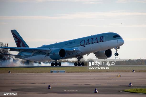 "An Airbus A350 plane of Qatar Airways from Doha is pictures after it landed at Berlin's airport ""Berlin Brandenburg Airport Willy Brandt"", during the..."