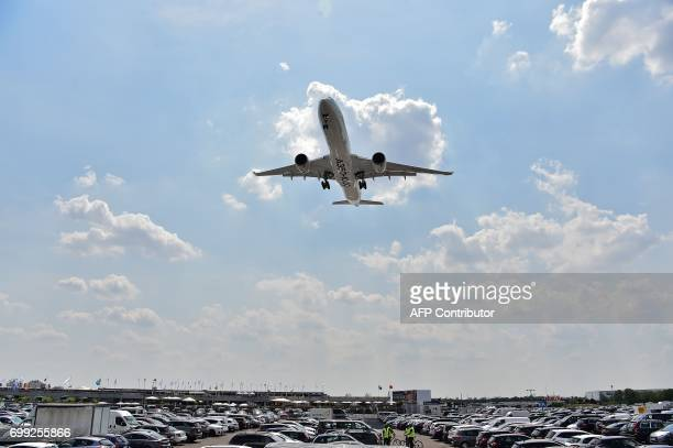 An Airbus A3501000 lands during a flying display at the International Paris Air Show in Le Bourget outside Paris on June 21 2017 / AFP PHOTO /...