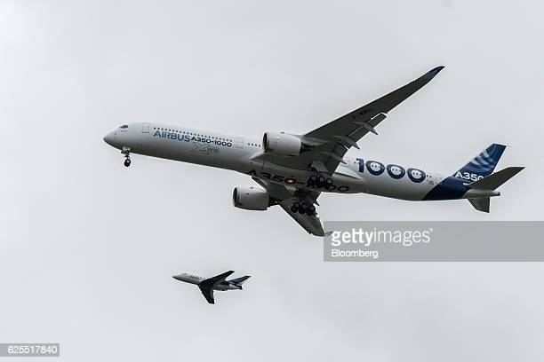 An Airbus A3501000 twinjet passenger plane manufactured by Airbus Group SE comes into land following its first flight at the Airbus factory in...