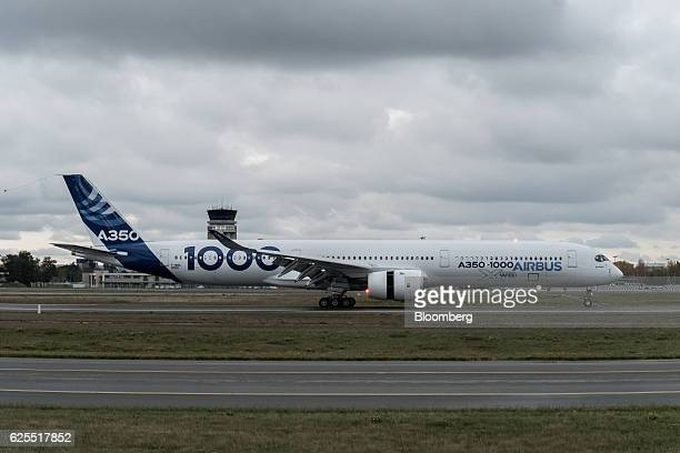 An Airbus A3501000 twinjet passenger plane manufactured by Airbus Group SE taxis following its first flight at the Airbus factory in Toulouse France...