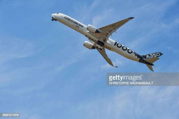 An Airbus A350-1000 XWB jet airliner performs its show flight during the International Paris Air Show at Le Bourget, north of Paris, on June 20,...