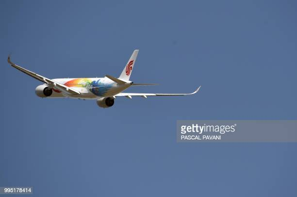 An Airbus A350900 belonging to the Air China airline company flies on July 10 2018 at the Airbus delivery center in Colomiers southwestern France