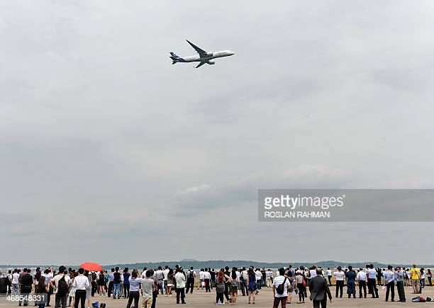 An Airbus A350900 does a fly over during the Singapore Air Show on February 11 2014 Asia's top aerospace and defence show opens February 11 in...
