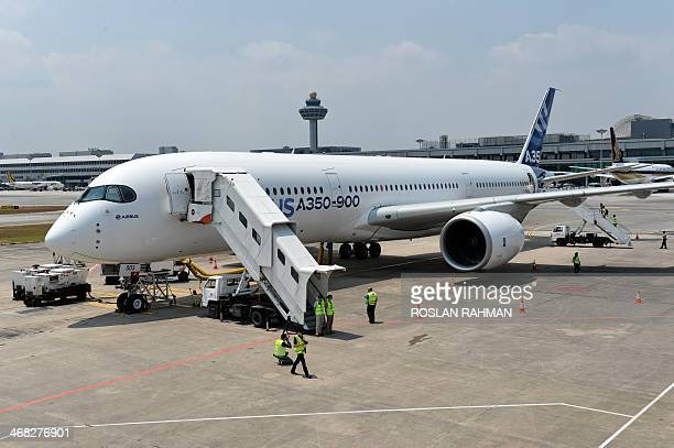 An Airbus A350900 sits on the tarmac during a media preview at Changi Interational Airport ahead of the Singapore Airshow on February 10 2014 Asia's...