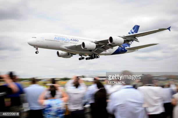 An Airbus A380 aircraft performs a flight display at the Farnborough Air Show in Hampshire southern England on July 16 2014 European aircraft maker...