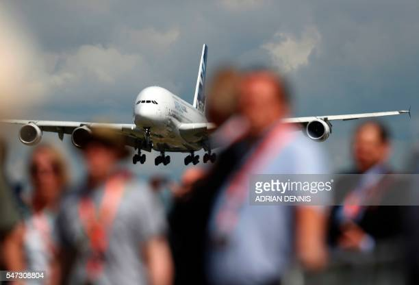 TOPSHOT An Airbus A380 aircraft prepares to land after performing in a flying display at the Farnborough Airshow south west of London on July 14 2016...