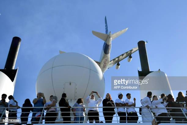 An airbus A380 flies over the RMS Queen Mary 2 cruise on June 25 2017 off SaintNazaire to give the start of The Bridge 2017 'The Bridge 2017' is a...