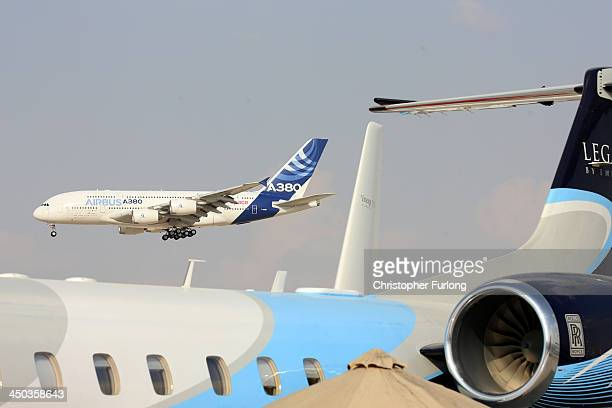 An Airbus A380 gives a flying display during the Dubai Airshow on November 18 2013 in Dubai United Arab Emirates The Dubai Air Show is the premier...