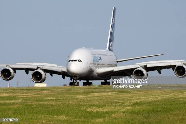 An Airbus A380 lands at the RolandGarros airport near the city of SaintDenisdelaReunion after an exhibition flight over the Indian ocean island of La...