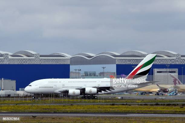 An Airbus A380 of Emirates Airlines is pictured in front of hangars of the European aircraft manufacturer Airbus on October 19 at the ToulouseBlagnac...