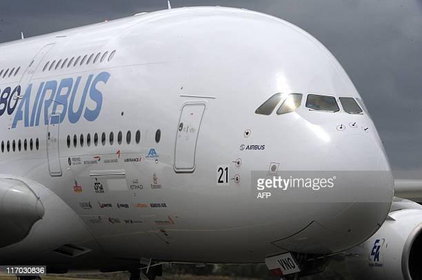 An Airbus A380 plane lands at Le Bourget airport near Paris on June 19 2011 on the eve of the opening of the Paris International Air Show Airbus will...
