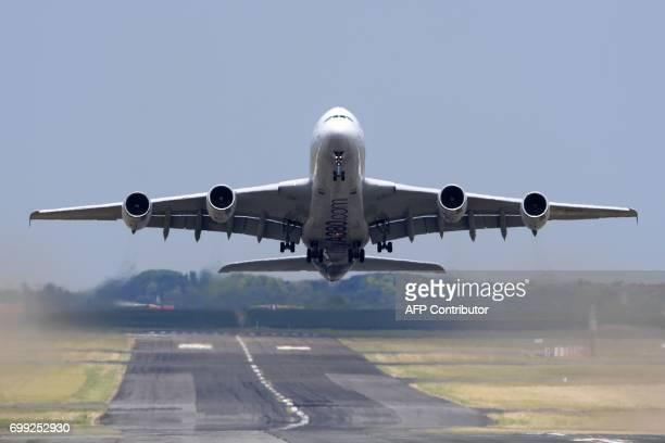 An Airbus A380 takes off during a flying display at the International Paris Air Show in Le Bourget outside Paris on June 21 2017 / AFP PHOTO /...
