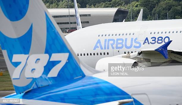 An Airbus A380 taxis past a Boeing 787 Dreamliner at the Farnborough air show in Hampshire England on July 15 2014 The biennial event sees leading...