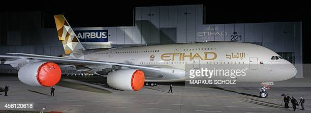 An Airbus A380 with the new design of Etihad Airways is pictured on Septemner 25 2014 in Hamburg on the Airbus facilities in front of a paint shop...