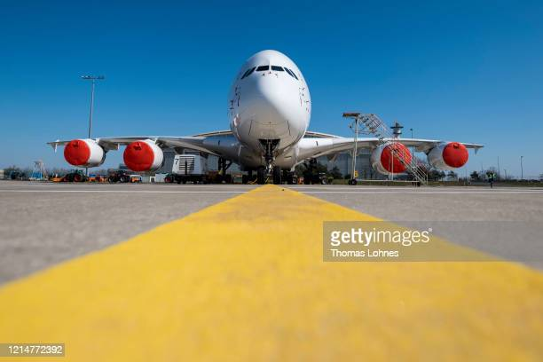 An Airbus A380-800 passenger plane of German airline Lufthansa stands parked and pulled from service at Frankfurt Airport on March 25, 2020 in...