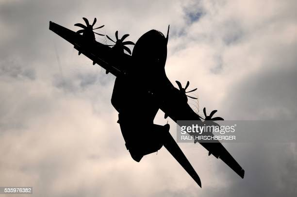 An Airbus A400M flies over the International Aerospace Exhibition in Schoenefeld on May 31, 2016. - The Aerospace Exhibition at Schoenefeld Airport...