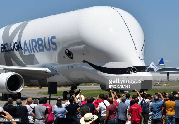 TOPSHOT An Airbus 'BelugaXL' aircraft taxis in front of Airbus employees at ToulouseBlagnac on July 19 after its maiden test flight of some four...