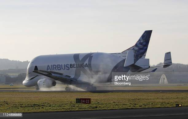 An Airbus BelugaXL supertransporter aircraft lands at Hawarden Airport near the Airbus SE plant in Broughton UK on Thursday Feb 14 2019 Airbus Chief...