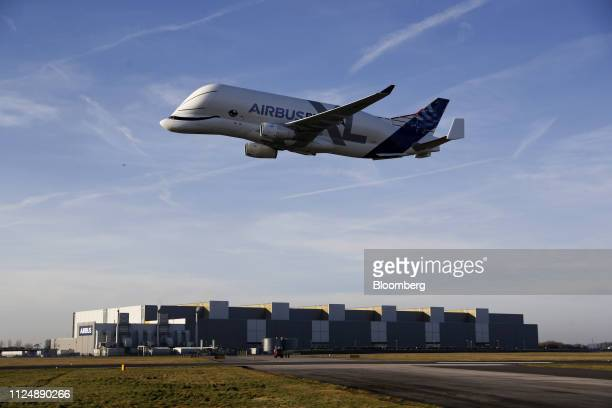 An Airbus BelugaXL supertransporter aircraft makes a flypast at Hawarden Airport near the Airbus SE plant in Broughton UK on Thursday Feb 14 2019...
