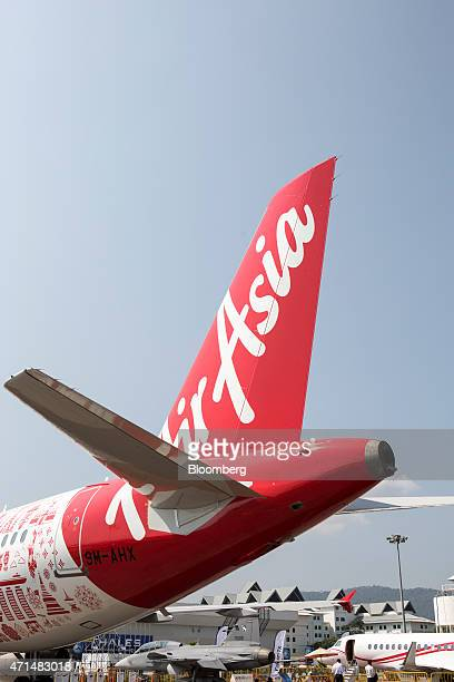 An Airbus Group NV A320 aircraft operated by AirAsia Bhd stands on the tarmac before its unveiling at the Langkawi International Maritime and...