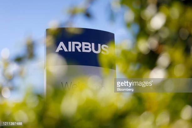 An Airbus logo stands outside the Airbus SE assembly plant in Broughton UK on Thursday April 30 2020 Industrial giants like Airbus Siemens AG and...
