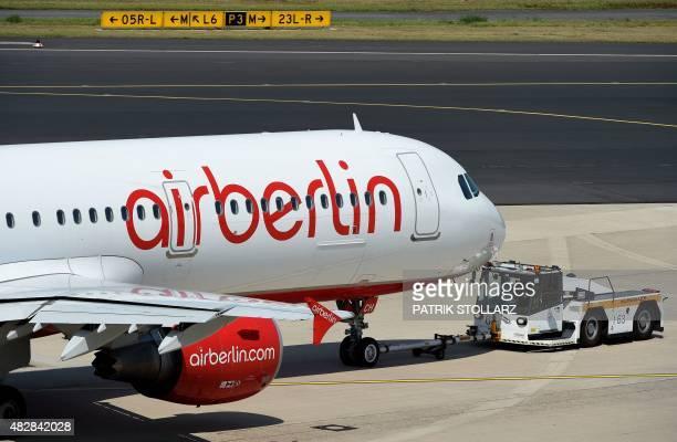 An Airbus of German airline 'Air Berlin' rolls on the runway on August 3 2015 in Duesseldorf western Germany AFP PHOTO / PATRIK STOLLARZ