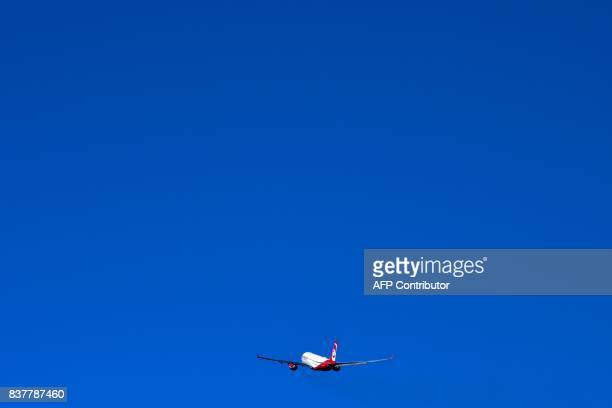An Airbus of German airline 'Air Berlin' takes off at the airport on August 23 2017 in Duesseldorf western Germany / AFP PHOTO / PATRIK STOLLARZ