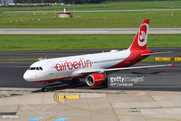 An Airbus operated by German airline 'Air Berlin' rolls on the runway on August 23 2017 in Duesseldorf western Germany / AFP PHOTO / PATRIK STOLLARZ