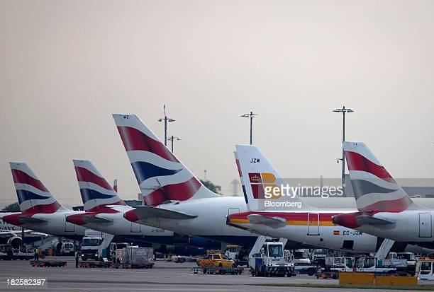 An Airbus SAS 321 aircraft second right operated by Iberia a unit of International Consolidated Airlines Group SA sits amongst aircraft operated by...